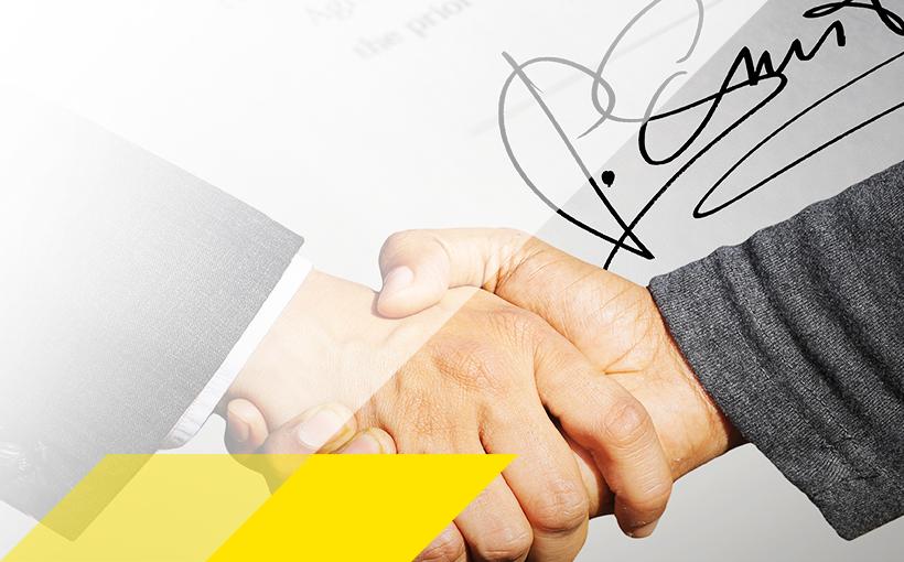 Handschlag und Unterschrift